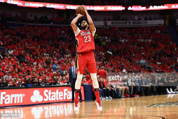 Anthony Davis of the New Orleans Pelicans takes a three point shot against the Portland Trail Blazers during the second half of Game Four of the...