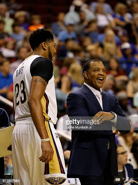 Anthony Davis of the New Orleans Pelicans talks with Head Coach Alvin Gentry during the game against the Dallas Mavericks during a preseason game on...