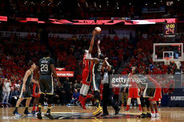 Anthony Davis of the New Orleans Pelicans tips off Kevin Durant of the Golden State Warriors during Game Four of the Western Conference Semifinals of...