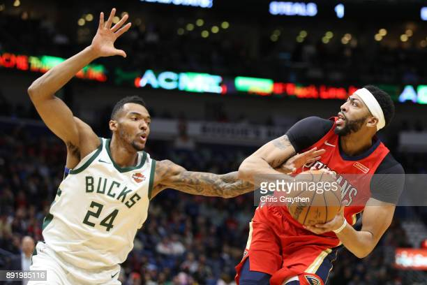 Anthony Davis of the New Orleans Pelicans tries to make a shot over Joel Bolomboy of the Milwaukee Bucks at Smoothie King Center on December 13 2017...