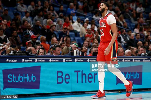 Anthony Davis of the New Orleans Pelicans walks in front of a StubHub sign during a NBA game against the Dallas Mavericks at the Smoothie King Center...