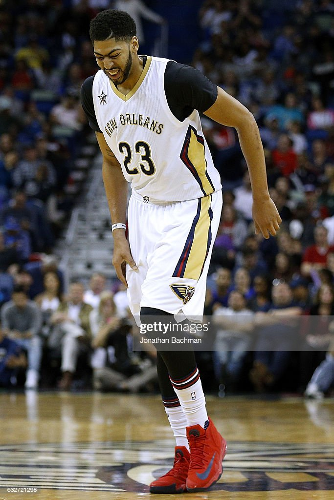 Anthony Davis #23 of the New Orleans Pelicans walks off the court injured during the first half of a game against the Oklahoma City Thunder at the Smoothie King Center on January 25, 2017 in New Orleans, Louisiana.