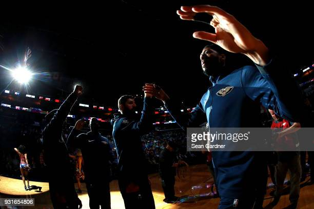 Anthony Davis of the New Orleans Pelicans walks out onto the court prior to a of a NBA game against the Charlotte Hornets at the Smoothie King Center...