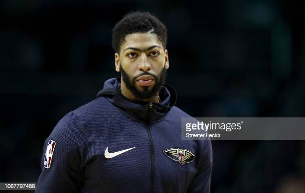 Anthony Davis of the New Orleans Pelicans watches on before their game against the Charlotte Hornets at Spectrum Center on December 2 2018 in...
