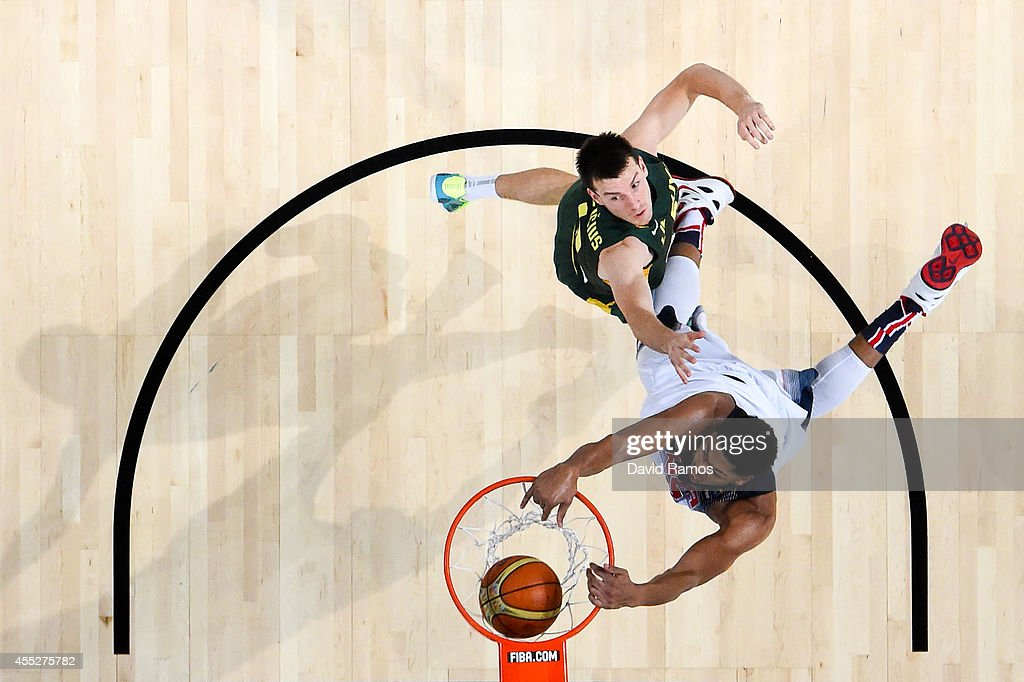 Anthony Davis #14 of the USA Basketball Men's National Team dunks the ball against Kisistof Lavrinovic #12 of the Lithuania Basketball Men's National Team during a 2014 FIBA Basketball World Cup semi-final match between USA and Lithuania at Palau Sant Jordi on September 11, 2014 in Barcelona, Spain.