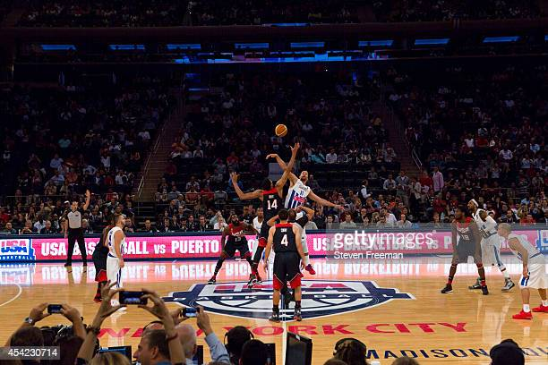 Anthony Davis of the USA Basketball Men's National Team jumps the opening tip against Ricardo Sanchez of the Puerto Rico National Team on August 22...