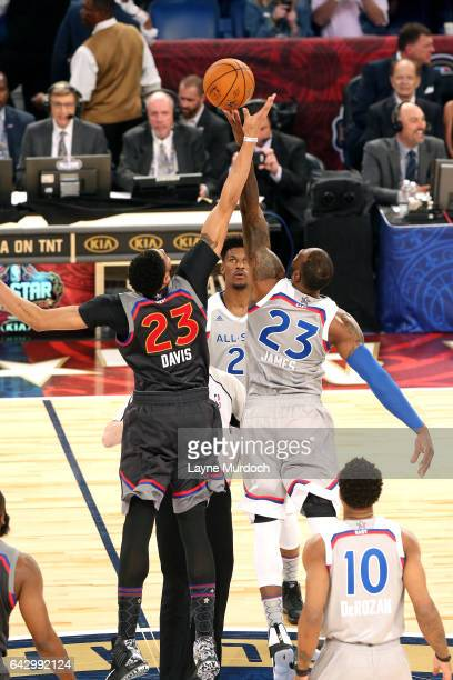 Anthony Davis of the Western Conference AllStar Team goes for the tip off against LeBron James of the Eastern Conference AllStar Team during the NBA...