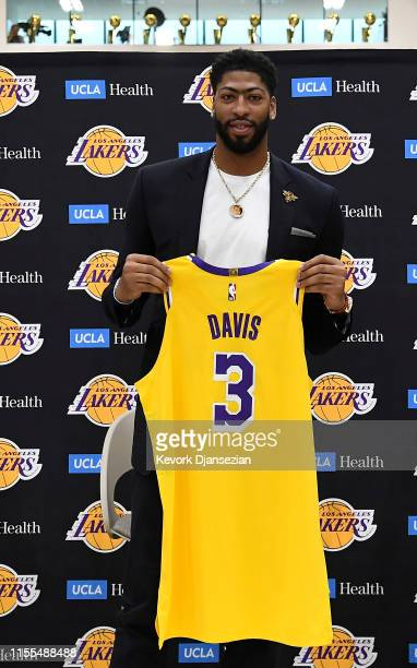 Anthony Davis poses with his jersey as he is introduced as the newest player of the Los Angeles Lakers during a press conference at UCLA Health...
