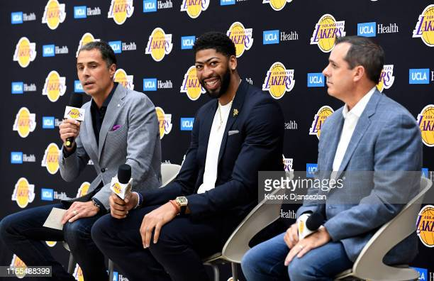 Anthony Davis smiles during a news conference to be introduced as the newest player of the Los Angeles Lakers with general manager Rob Pelinka head...