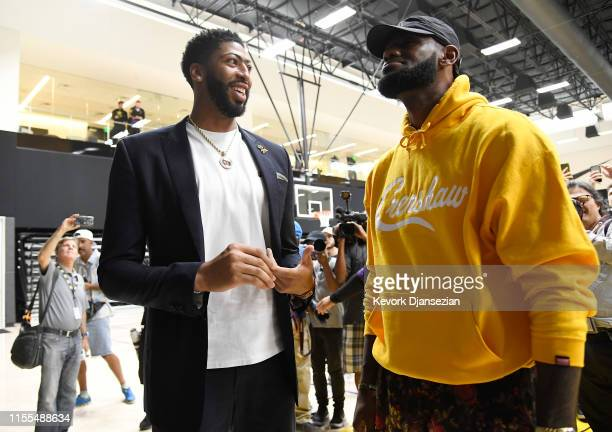 Anthony Davis talks with LeBron James after during a press conference where Davis was introduced as the newest player of the Los Angeles Lakers at...