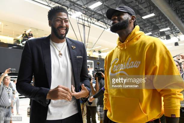 Anthony Davis talks with LeBron James as Davis is introduced as the newest player of the Los Angeles Lakers during a press conference at UCLA Health...