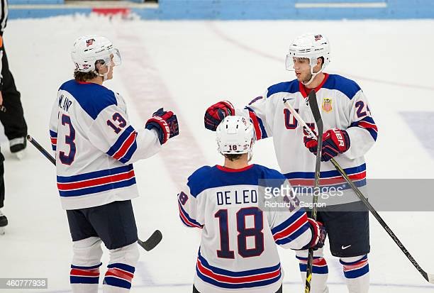 Anthony DeAngelo of the USA National Junior Team celebrates his goal with teammates Sonny Milano and Chase De Leo $18 during the third period of NCAA...
