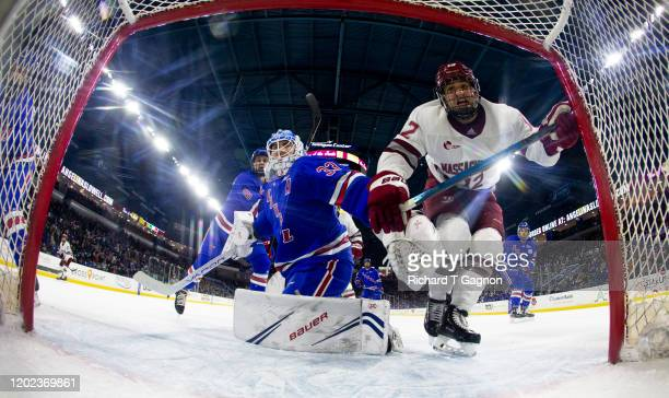 Anthony Del Gaizo of the Massachusetts Minutemen bumps into Tyler Wall of the Massachusetts Lowell River Hawks during NCAA men's hockey at the...