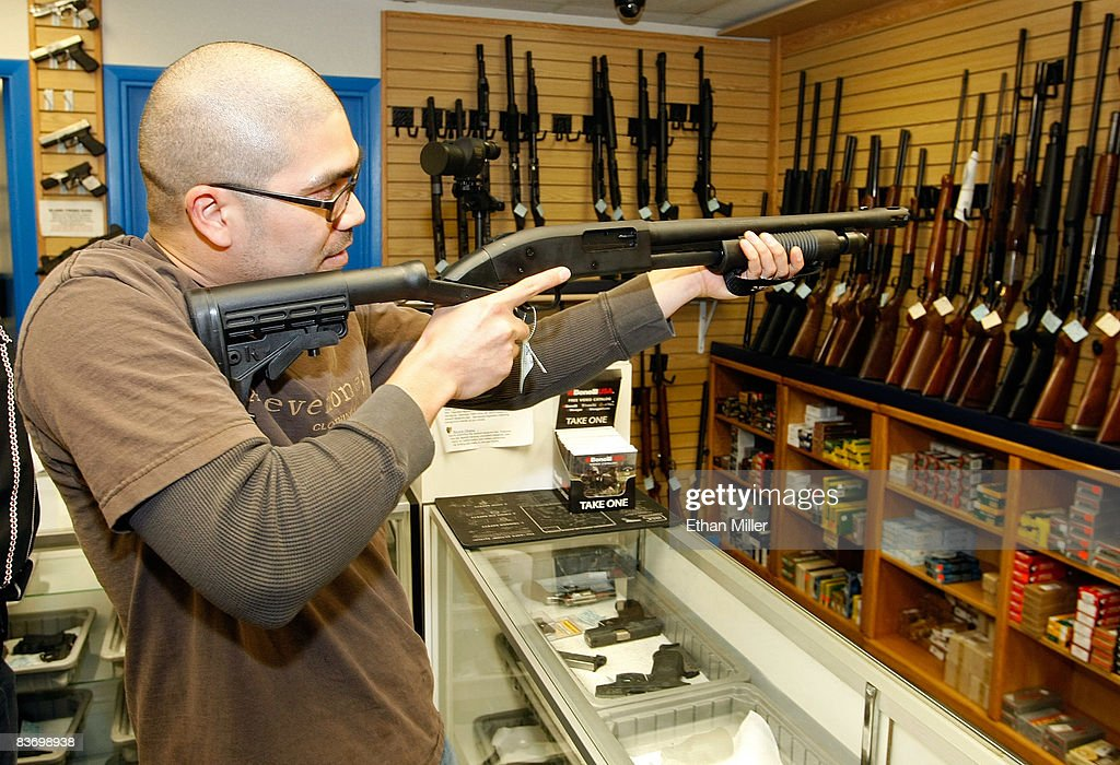 Anthony Del Rosario of Nevada examines a shotgun at The Gun Store November 14, 2008 in Las Vegas, Nevada. Store manager Cliff Wilson said he's seen a large spike in sales since Barack Obama was elected president on November 4, with customers citing fears about the president-elect's record on firearms. The election, combined with a slumping economy, has contributed to an overall increase of 25-30 percent in gun sales at the store, Wilson said.