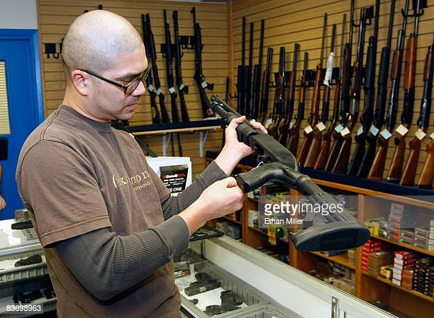Anthony Del Rosario of Nevada looks at a shotgun at The Gun Store November 14 2008 in Las Vegas Nevada Store manager Cliff Wilson said he's seen a...