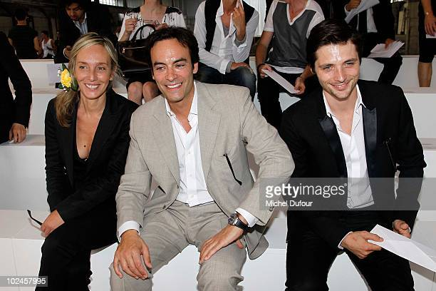Anthony Delon and guest as well as Raphael Personnanz attend the Dior Homme show as part of Paris Menswear Fashion Week Spring/Summer 2011 at Halle...