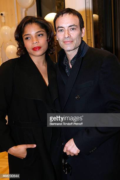 Anthony Delon and his companion Jina Djemba attend the Tommy Hilfiger Boutique Opening at Boulevard Capucines on March 31 2015 in Paris France