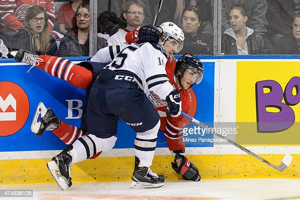 Anthony Deluca of the Rimouski Oceanic checks Stephen Desrocher of the Oshawa Generals in Game Two during the 2015 Memorial Cup at the Pepsi Coliseum...