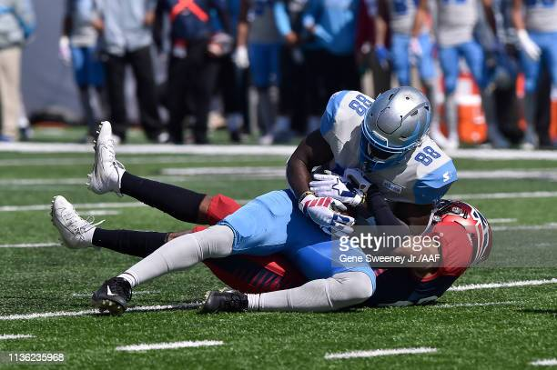 Anthony Denham of the Salt Lake Stallions is tackled by Brandon Maiden of the Memphis Express for a first down in the first quarter at Rice Eccles...