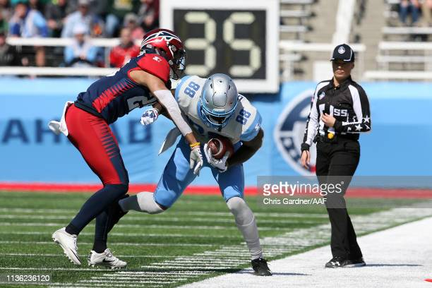 Anthony Denham of the Salt Lake Stallions runs the ball against the Memphis Express as the referee looks on in the first quarter at Rice Eccles...