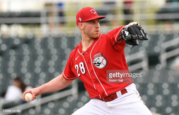 Anthony DeSclafani of the Cincinnati Reds delivers a pitch against the Oakland Athletics during a spring training game at Goodyear Ballpark on...