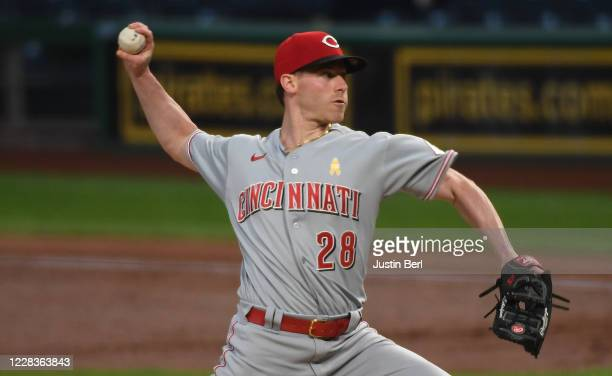 Anthony DeSclafani of the Cincinnati Reds delivers a pitch in the second inning during the game against the Pittsburgh Pirates at PNC Park on...