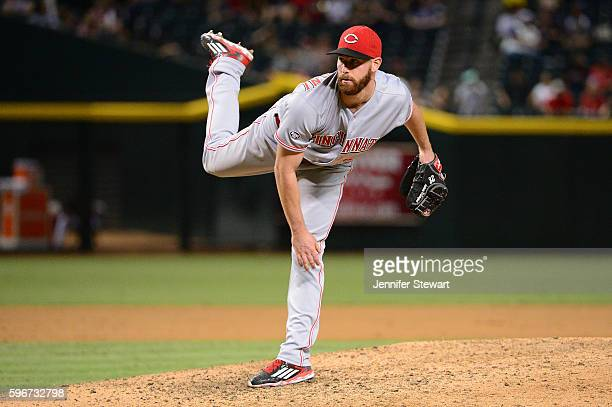 Anthony DeSclafani of the Cincinnati Reds delivers a pitch in the ninth inning against the Arizona Diamondbacks at Chase Field on August 27 2016 in...