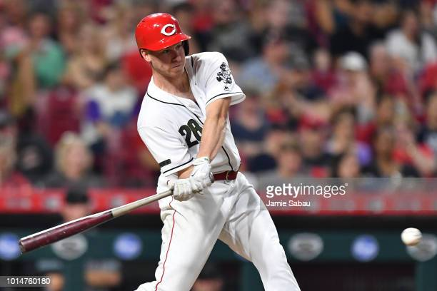 Anthony DeSclafani of the Cincinnati Reds hits a single in the seventh inning against the Arizona Diamondbacks at Great American Ball Park on August...