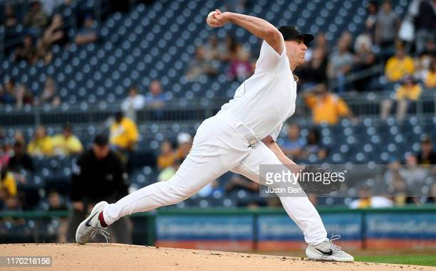 Anthony DeSclafani of the Cincinnati Reds in action during the game against the Pittsburgh Pirates at PNC Park on August 23, 2019 in Pittsburgh,...
