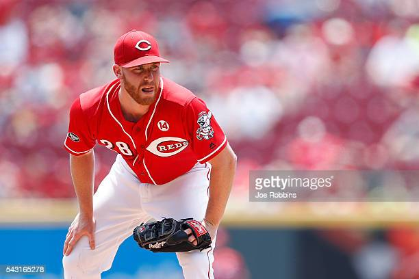 Anthony DeSclafani of the Cincinnati Reds looks on while pitching against the San Diego Padres in the first inning of the game at Great American Ball...