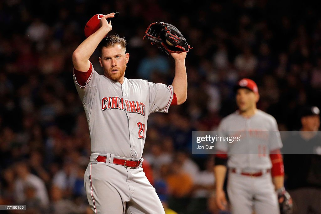 Anthony DeSclafani #28 of the Cincinnati Reds reacts after giving up a double to David Ross #3 of the Chicago Cubs (not pictured) during the seventh inning at Wrigley Field on June 14, 2015 in Chicago, Illinois.