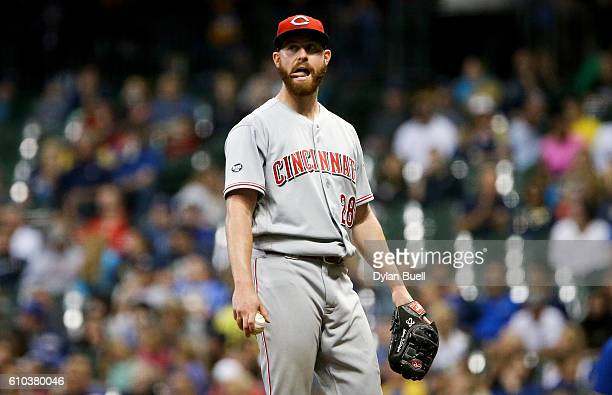 Anthony DeSclafani of the Cincinnati Reds reacts after giving up a walk in the seventh inning against the Milwaukee Brewers at Miller Park on...