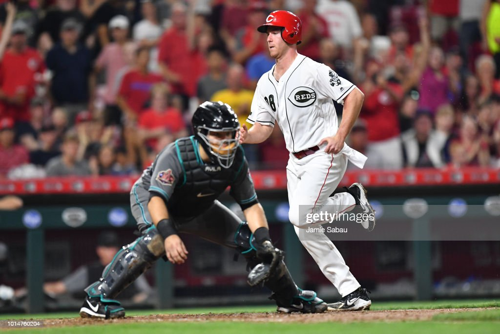Anthony DeSclafani #28 of the Cincinnati Reds scores off a throwing error in the seventh inning against the Arizona Diamondbacks at Great American Ball Park on August 10, 2018 in Cincinnati, Ohio. Cincinnati defeated Arizona 3-0.