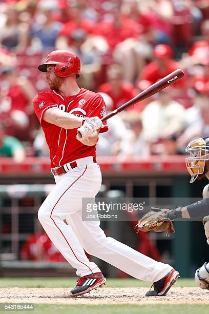 Anthony DeSclafani of the Cincinnati Reds singles to center field to drive in a run against the San Diego Padres in the sixth inning of the game at...