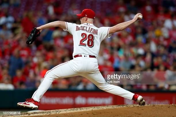 Anthony DeSclafani of the Cincinnati Reds throws a pitch during the game against the San Francisco Giants at Great American Ball Park on August 17...