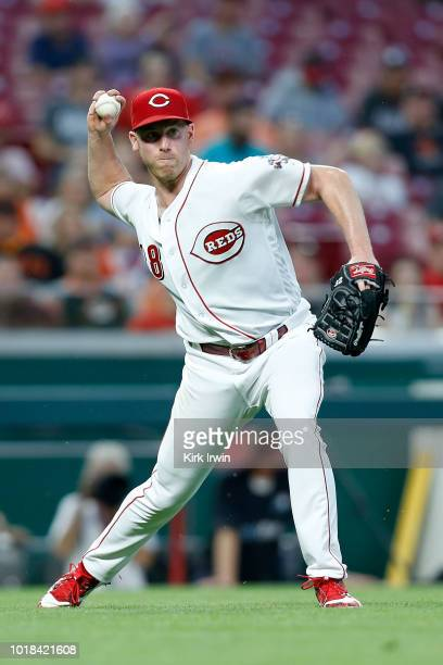 Anthony DeSclafani of the Cincinnati Reds throws out Andrew McCutchen of the San Francisco Giants at first base during the fifth inning at Great...