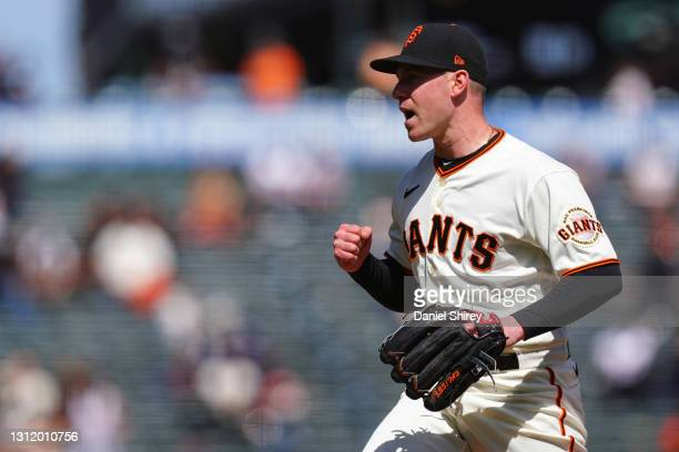 Anthony DeSclafani of the San Francisco Giants reacts to striking out Sam Hilliard of the Colorado Rockies to end the sixth inning at Oracle Park on...
