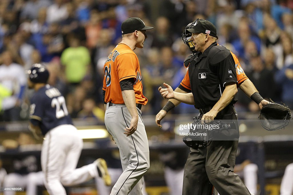 Anthony DeSlafani #28 of the Miami Marlins yells at home plate umpire Jeff Kellogg #8 after getting ejected from the game for hitting Carlos Gomez of the Milwaukee Brewers with a pitch in the bottom of the sixth inning at Miller Park on September 11, 2014 in Milwaukee, Wisconsin.