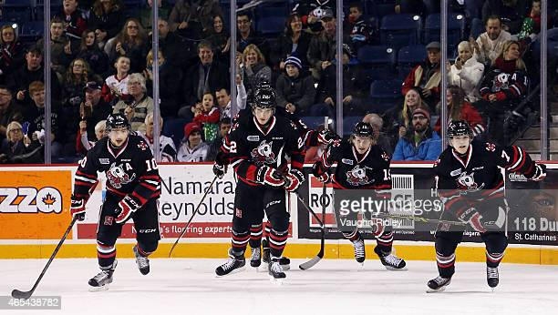 Anthony DiFruscia Ryan Mantha and Matt Gillard of the Niagara IceDogs skate back to the bench after Mikkel Aagaard scored a goal during an OHL game...
