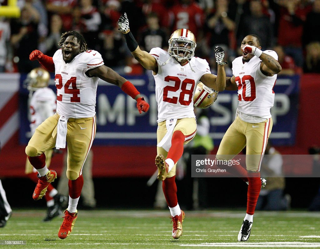 Anthony Dixon #24, defensive back Darcel McBath #28 and defensive back Perrish Cox #20 of the San Francisco 49ers react after stopping the Atlanta Falcons on fourth down in the fourth quarter in the NFC Championship game at the Georgia Dome on January 20, 2013 in Atlanta, Georgia.