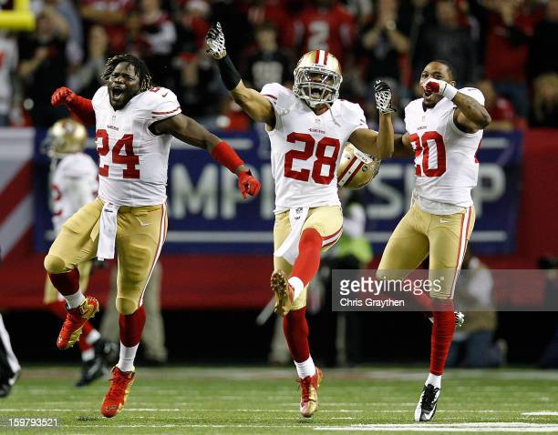 Anthony Dixon defensive back Darcel McBath and defensive back Perrish Cox of the San Francisco 49ers react after stopping the Atlanta Falcons on...