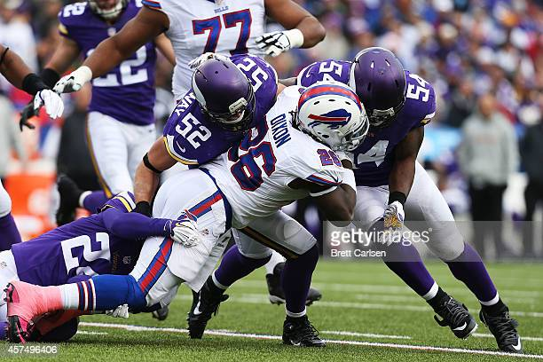 Anthony Dixon of the Buffalo Bills is tackled by Captain Munnerlyn of the Minnesota Vikings Chad Greenway of the Minnesota Vikings and Jasper...