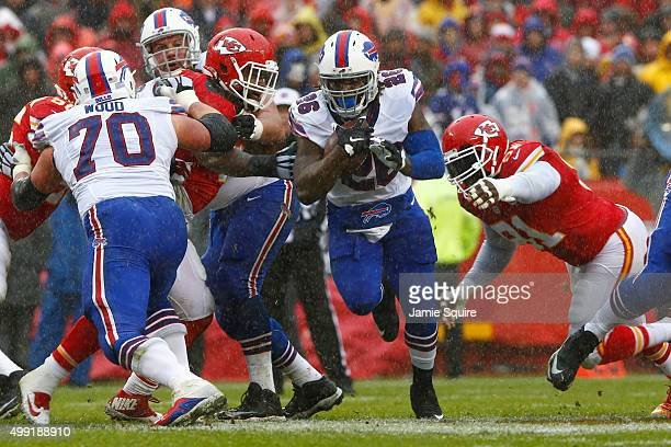 Anthony Dixon of the Buffalo Bills rushes the ball avoiding the tackle attempt of Tamba Hali of the Kansas City Chiefs at Arrowhead Stadium during...