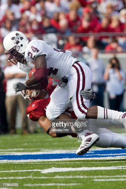 Anthony Dixon of the Mississippi State Bulldogs is tackled during their game against the Arkansas Razorbacks at War Memorial Stadium November 17 2007...
