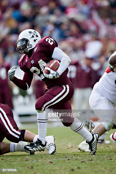 Anthony Dixon of the MIssissippi State Bulldogs runs with the ball against the Arkansas Razorbacks at Davis Wade Stadium on November 22 2008 in...