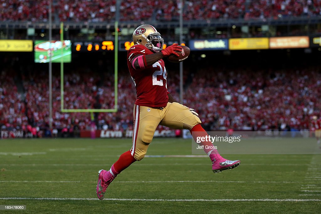 Anthony Dixon #24 of the San Francisco 49ers scores a touchdown in the second quarter against the Houston Texans during their game at Candlestick Park on October 6, 2013 in San Francisco, California.