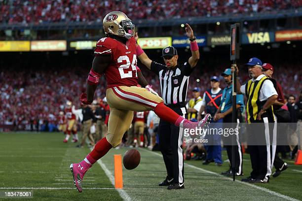 Anthony Dixon of the San Francisco 49ers scores a touchdown in the second quarter against the Houston Texans during their game at Candlestick Park on...