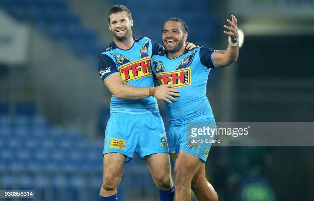 Anthony Don and Konrad Hurrell of the Titans celebrate the win during the round one NRL match between the Gold Coast Titans and the Canberra Raiders...
