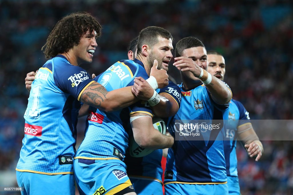 Anthony Don of the Titans celebrates after scoring a try with team mates during the round 17 NRL match between the Gold Coast Titans and the St George Illawarra Dragons at Cbus Super Stadium on June 30, 2017 in Gold Coast, Australia.