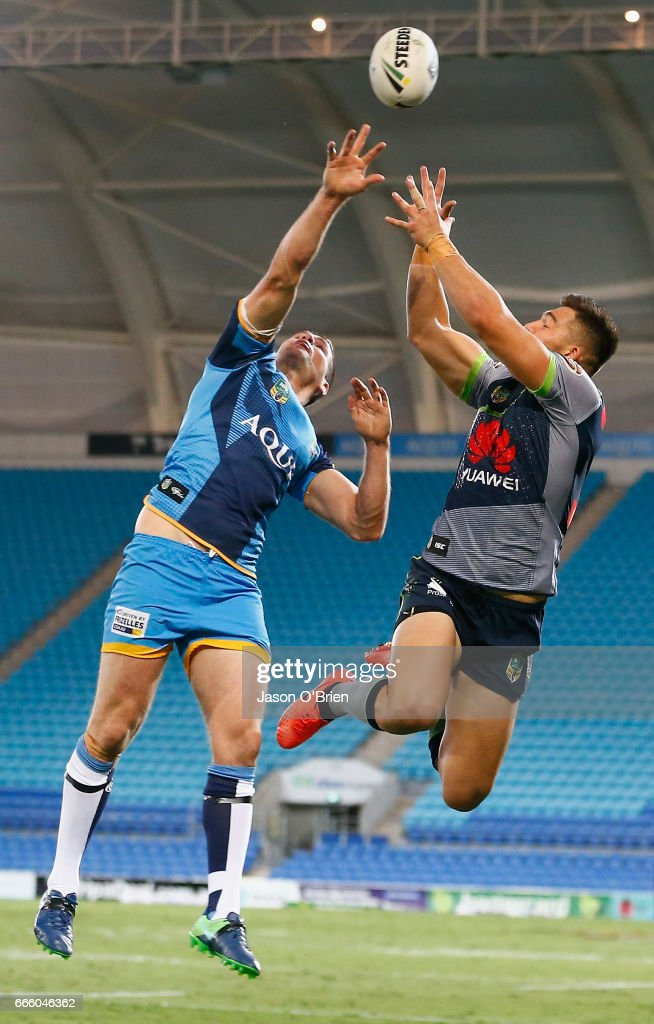 Anthony Don of the Titans contests a high ball with Nick Cotric of the Raiders during the round six NRL match between the Gold Coast Titans and the Canberra Raiders at Cbus Super Stadium on April 8, 2017 in Gold Coast, Australia.